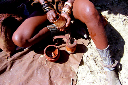 Himba lady preparing perfume. Picture: Karen Knott